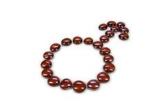 Símbolo masculino dos grânulos de vidro no vermelho Fotos de Stock