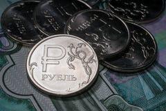 Símbolo novo moedas de um rublo Fotografia de Stock