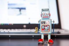 Símbolo para um bot do bate-papo ou bot social e algoritmos, portátil e tela imagem de stock