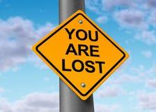 Símbolo perdido y confuso del poste indicador Fotos de archivo