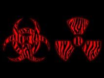 Símbolo radiactivo y del biohazard rojo Fotos de archivo