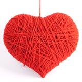Símbolo rojo de la dimensión de una variable del corazón hecho de las lanas Fotos de archivo