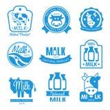 Símbolos azules y blancos de la leche ilustración del vector