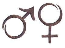 Símbolos de cobre forjados estilizados del varón y de la hembra Fotografía de archivo libre de regalías