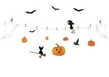Símbolos de Halloween en una línea de ropa Imagen de archivo