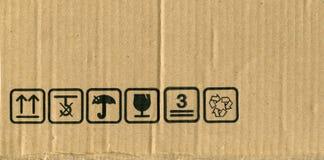 Símbolos de la caja de cartón Foto de archivo libre de regalías