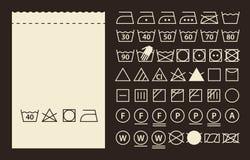 Símbolos de la etiqueta y el lavarse de la materia textil Imagen de archivo libre de regalías