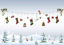 Símbolos de la Navidad en líneas de ropa Fotos de archivo libres de regalías