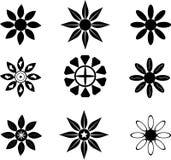 Símbolos de la silueta de la flor Foto de archivo libre de regalías