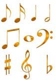 Símbolos de música del oro Imagen de archivo libre de regalías