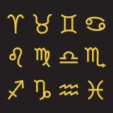 Símbolos de oro del zodiaco en fondo negro Fotos de archivo