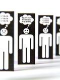 Símbolos de papel dos homens que pensam sobre a crise Fotografia de Stock Royalty Free
