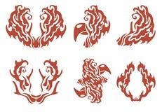 Símbolos decorativos llameantes: gallo y otros Imagen de archivo