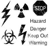 Símbolos del peligro de Grunge Imagen de archivo libre de regalías