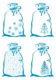 Símbolos do Natal em sacos Fotos de Stock