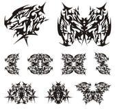 Símbolos enarbolados tribales de la cabeza del dragón Fotos de archivo libres de regalías