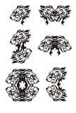 Símbolos flamejantes tribais da cabeça do leão Foto de Stock