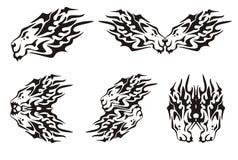 Símbolos flamejantes tribais das cabeças do leão Fotos de Stock Royalty Free