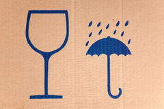Símbolos frágiles en la cartulina Fotografía de archivo libre de regalías