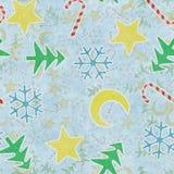 Símbolos inconsútiles de la Navidad del modelo en el papel azul Imágenes de archivo libres de regalías