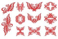 Símbolos llameantes del águila en estilo tribal Fotos de archivo libres de regalías