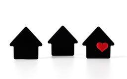 Símbolos pretos da casa no fundo branco Foto de Stock