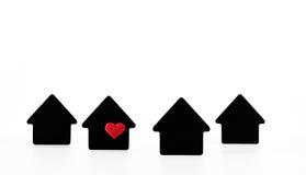 Símbolos pretos da casa no fundo branco Fotos de Stock