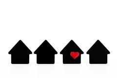 Símbolos pretos da casa no fundo branco Fotografia de Stock Royalty Free