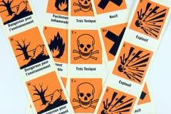 Símbolos químicos franceses do perigo Imagens de Stock