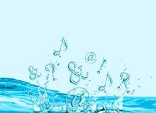 Símbolos que salpican en agua Foto de archivo