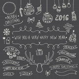 Símbolos tirados mão do ornamental do Natal Imagem de Stock