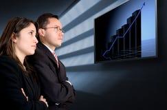 Sócios comerciais que prestam atenção a seu sucesso Fotos de Stock Royalty Free