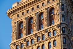 Södra sida av strykjärnbyggnaden i solljus, New York Royaltyfria Foton