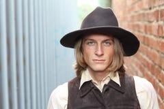 Södra VÄSTRA - en cowboy tar tid att vila och reflektera Arkivfoto