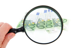Söka efter pengar Fotografering för Bildbyråer
