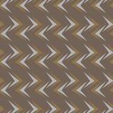 Sömlös abstrakt vektormodell på brun bakgrund Arkivfoto