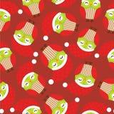 Sömlös bakgrund av julillustrationen med gulliga röda ugglor på röd bakgrund Stock Illustrationer