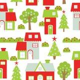 Sömlös bakgrund av julillustrationen med röda och gröna hus Stock Illustrationer