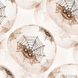 Sömlös bakgrund eller textur med spindlar och spindelnätet i brunt royaltyfria foton