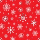 Sömlös bakgrund för jul med snöflingor Snöflingavektormodell på röd bakgrund Kan användas som julkort Royaltyfria Foton