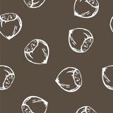 Sömlös bakgrund för vektor med kastanjen i vit på bakgrundsbrunt Royaltyfria Foton