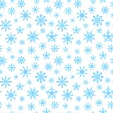 Sömlös bakgrund med blåa snöflingor Fotografering för Bildbyråer
