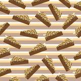 Sömlös bakgrund med den gulliga chokladkakan som är passande för barn, tapetserar och restpapper Arkivbild