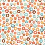 Sömlös bakgrund med donuts Royaltyfria Bilder
