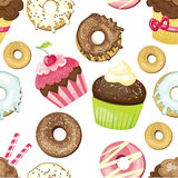 Sömlös bakgrund med olika sötsaker och efterrätter belagd med tegel donuts- och muffinmodell Gullig textur för inpackningspapper Arkivbilder