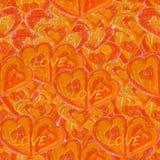 Sömlös bakgrund med orange hjärtor Arkivbild