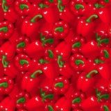 Sömlös bakgrund med röda spanska peppar. Arkivfoton