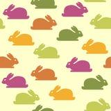 Sömlös bakgrund med roliga kaniner Arkivbild
