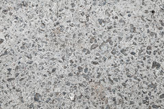 Sömlös bakgrundstextur av den gråa betongväggen royaltyfri fotografi