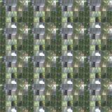 Sömlös fototextur av den lilla biten av spegelplattor för annons Arkivbild